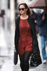 Pippa Middleton was ravishing in a pleated red leopard print frock with a gathered waist.