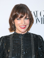 Milla Jovovich sported a cute bowl cut at the opening of What Goes Around Comes Around.