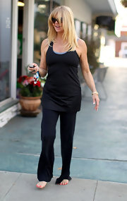 Goldie Hawn hit the nail salon in good spirits wearing a sporty black tank top and workout pants.