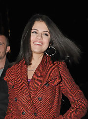 Selena wears silver hoops with her tweed jacket for this effortlessly stylish look.