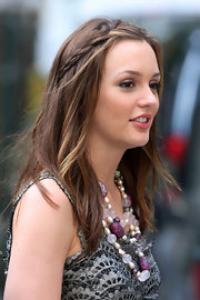 The partial braid helps pull Leighton's bangs away from her face.