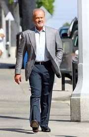 Kelsey Grammer looked smart in navy slacks and a gray blazer on the set of his movie.