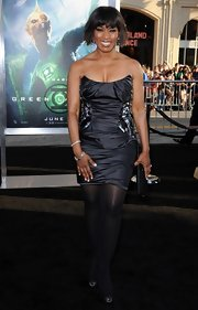 Angela Bassett showed off her toned shoulders with a ruched strapless cocktail dress with beading on either side.