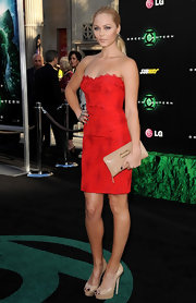 Laura was ladylike in her little red dress at the premiere of the 'Green Lantern.' She finished off her look with nude peep toe pumps.
