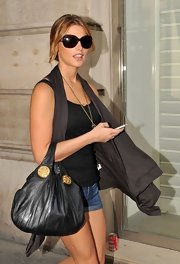 Ashley Greene was spotted in Paris toting around a leather shoulder bag.