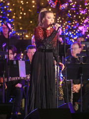 Rachel Platten performed at the Grove Christmas with Seth MacFarlane wearing a Pamella Roland gown, featuring an ombre beaded bodice and a sheer skirt.