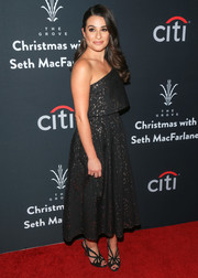 Lea Michel looked appropriately festive in a Lela Rose off-one-shoulder dress, in black with silver speckles, at the Grove Christmas with Seth MacFarlane.