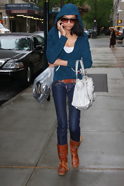 Chanel wore moccasin inspired brown leather boots while out in NY.