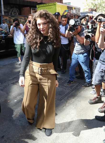 Lorde teamed her top with wide-leg khakis.
