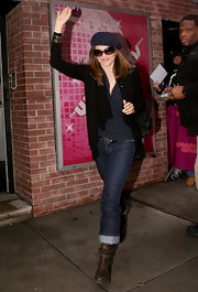 Lucy Lawless waved to founds outside the 'Wendy Williams' show in a pair of distressed brown leather boots.