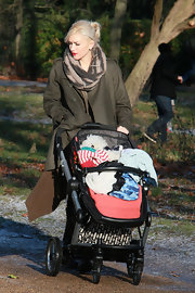 Gwen bundled up at the park in a cozy knit scarf.