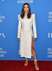 Eva Longoria complemented her frock with a pair of PVC and leather ankle-strap sandals by Gianvito Rossi.