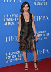 Alison Brie teamed her frock with sexy strappy sandals by Jimmy Choo.