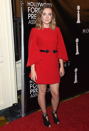 Saoirse Ronan kept it simple yet classy at the HFPA Grants Banquet in a red mini dress with bell sleeves.