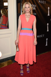 Elizabeth Banks went all out with the colors, wearing purple Jimmy Choo strappy sandals with her dress.