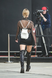 Hailey Baldwin rehearsed for the Tommy Hilfiger show sporting a white backpack and black outfit combo.