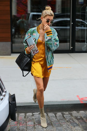 Hailey Baldwin cut a vibrant figure on the streets of New York City in a printed bomber jacket by Gucci.