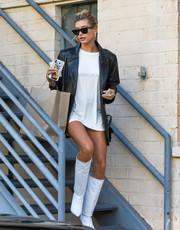Hailey Bieber layered a black leather blazer by J Brand over a white shirt for a day out in LA.