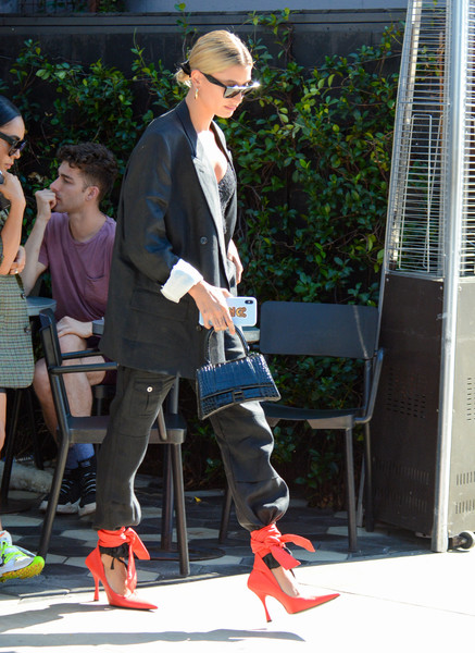 Hailey Bieber Leather Purse [footwear,jeans,fashion,street fashion,leg,outerwear,shoe,denim,blazer,eyewear,jeans,hailey baldwin,socialite,fashion,celebrity,model,street fashion,california,los angeles,wedding,justin bieber,fashion,model,celebrity,wedding,socialite,jeans,hailey rhode bieber,kendall jenner,alec baldwin]