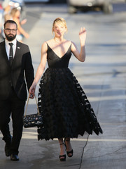 An embellished black bag with a gold chain strap polished off Haley Bennett's elegant look.
