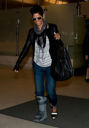 Halle Berry hobbled through the airport in boyfriend jeans and a collarless leather jacket.