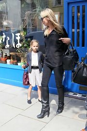 Wearing a gray pinstripe blazer, bag dangling on her arm, Lila obviously has the makings of a fashionista.