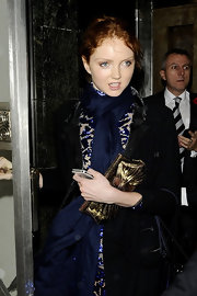 Lily Cole carried a super-chic metallic gold frame clutch when she attended the Harper's Bazaar Women of the Year Awards.