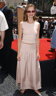 Calista Flockhart opted for a soft pale pink look with this long skirt paired with a matching knit top.