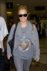 Hayden wore a pair of classic black shades to LAX.