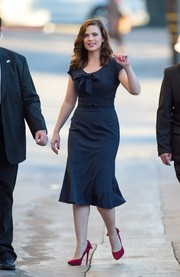 Hayley Atwell visited 'Jimmy Kimmel Live!' oozing vintage charm in a bow-adorned navy dress that fit her shapely figure like a glove.