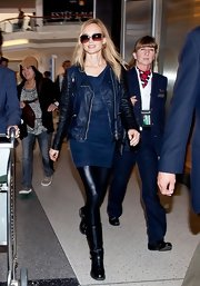 Heather Graham chose an all-blue look when she rocked this navy leather jacket over a blue mini dress.