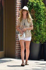 Heidi paired white short shorts with a longer printed blouse for a light and airy summertime look.
