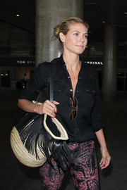 Heidi Klum's Saint Laurent fringed straw tote looked like the perfect summertime accessory!