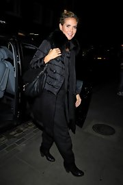 Heidi Klum completed her black-on-black-on-black with even more black—a classic pair of Chelsea boots!