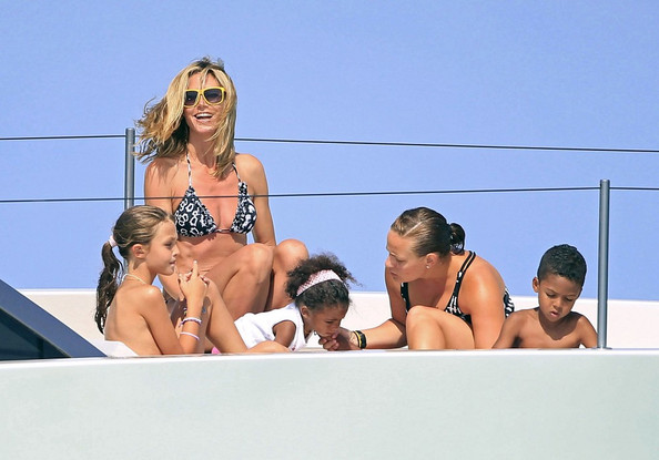 ... a tiny bikini as she and Seal, along with their four children, Leni (b.