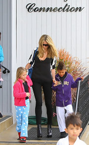 Heidi Klum was out and about in black leather platform ankle boots.