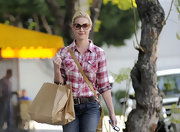 Katherine Heigl simplified her shopping style in a red and white plaid button up and jeans.
