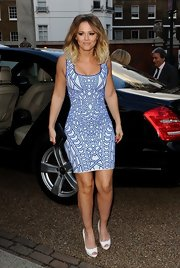 Kimberley Walsh chose this geometric kaleidoscopic-print dress for her look at the 'Hello' Magazine celebration.