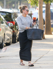 Hilary Duff grabbed dinner wearing a cozy gray crewneck sweater.
