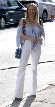 Hilary Duff filmed 'Younger' looking summer-chic in a pastel-blue cold-shoulder blouse.