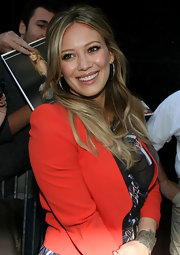 Hilary Duff wore her hair casually half up, half down with a few soft waves on 'Good Morning America'.