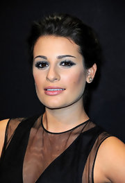 Lea Michele wore a silver-blue shadow to the Hogan by Karl Lagerfeld show. To try her look at home begin by sweeping black eye pencil along the top and bottom lash lines and on the inner rims of eyes. Next, apply a deep blue shadow to upper lids and blend a lighter shade of blue into creases. Then add a light metallic sliver shadow to the inner corners of the eyes and under the brow bone. To finish this super hot look, apply several coats of a volumizing mascara.
