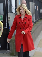 Holly Willoughby chose a vibrant red wool coat for her daytime look while out in London.