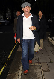 Anthony Hopkins shows his flair for accessorizing in red shoes and a black-and-white checked newsboy cap.