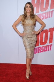 Sofia Vergara put her curves on display in an embroidered gold cocktail dress by Georges Chakra Couture at the premiere of 'Hot Pursuit.'
