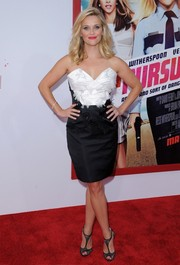 Reese Witherspoon sealed off her glam ensemble with a pair of black lace T-strap sandals by Christian Louboutin.