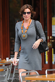 The addition of this tribal-inspired statement necklace dressed up LuAnn's simple sweater dress on the streets of NYC.