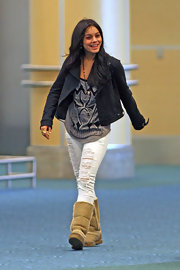 Vanessa Hudgens smiled as she made her way through Vancouver International in a leather jacket.