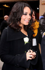 Vanessa Hudgens made an appearance on 'Live! With Kelly' wearing her layered 'do in tousled waves and curls.