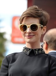 Anne Hathaway accessorized with a pair of Karen Walker shades.